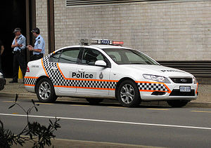 ACT Police vehicle (Ford Falcon FG) and unifor...