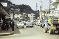 "ASC Leiden - F. van der Kraaij Collection - 05 - 035 - A street view of Waterside, with pedestrians, cars and vendors. ""Mobil"" en ""Texaco"" - Monrovia, Waterside, Montserrado, Liberia, 1975.tif"