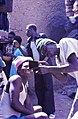 ASC Leiden - W.E.A. van Beek Collection - Dogon tourism 06 - Two men inspect a Kodak instant photo, Tireli, Mali 1990.jpg