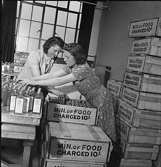 "Minister of Food - Women packing bottles of cod liver oil into crates stamped with the words ""Min. of Food Charged 10 shillings"""