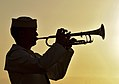 A Sailor plays taps at sunset. (8263436733).jpg