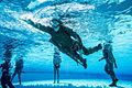 A U.S. Marine with 1st Marine Logistics group participates in the water survival advanced course on Camp Pendleton, California, June 14, 2017.jpg