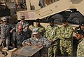 A U.S. Soldier, center front, with the 539th Transportation Company shows members of the Kuwait National Guard part of a heavy equipment transporter system in a motor pool at Camp Arifjan, Kuwait, Nov. 4, 2013 131104-A-HY046-263.jpg