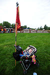 A baby sleeps in a stroller next to the guidon of the U.S. Army 56th Engineer Company (Vertical), 2nd Engineer Brigade, during the brigade's special event, called Arctic Trailblazer Week, at Cottonwood Park 120810-F-LX370-491.jpg