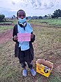 A street child in Rwanda after having obtained his marks at school.jpg