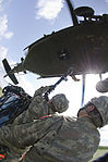 A team of Turkish Army Soldiers attach a pallet of water to a UH-60 Black Hawk helicopter during sling load operations at Camp Novo Selo, Kosovo, July 13, 2013 130713-A-XD724-915.jpg