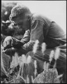A young Marine finds a moment of quiet and solitude in which to offer up a prayer for the safety of himself and his... - NARA - 532423.tif