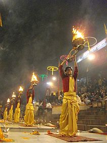 Aarti raised up during evening Ganga aarti, Varanasi.jpg