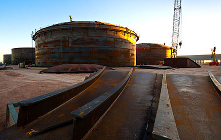 Construction of the Salt Tanks which provide efficient thermal energy storage so that output can be provided after the sun goes down, and output can be scheduled to meet demand requirements. The 280 MW Solana Generating Station is designed to provide six hours of energy storage. This allows the plant to generate about 38 percent of its rated capacity over the course of a year. Abengoa Solar (7336087392).jpg