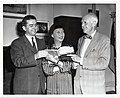 Actress Anna May Wong is presented a book on the history of Boston by Deputy Mayor John McMorrow and former Fire Commissioner Russel Codman (13243485005).jpg