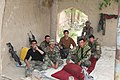 Afghan National Army (ANA) commandos rest in the shade April 1, 2012, after conducting patrols in Panjwai district, Kandahar province, Afghanistan 120401-A-NC985-105.jpg