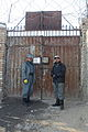 Afghan Uniformed Police officers stand guard at a gate of the Afghan Uniformed Police prison in Pul-e Alam district, Logar province, Afghanistan, Jan 120128-A-BZ540-092.jpg