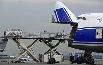 Cargo nose door open with cargo loader AirBridgeCargo Airlines Boeing 747-200F nose loading door open and cargo loader at Sheremetyevo International Airport.jpg