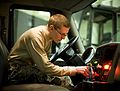 Airman 1st Class James Adams tests the hydraulic switches on a truck.jpg