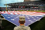 Airmen from Whiteman Air Force Base perform a flag detail during Armed Forces Night at Kauffman Stadium (21501800232).jpg