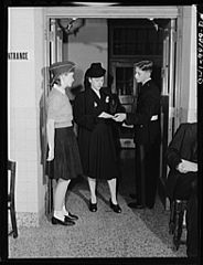 An applicant for a ration book being given directions 8d41119v.jpg