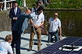 Andé Kuipers baptises TU Delft Solar Boat.JPG