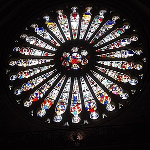 Zodiac - Angers Cathedral South Rose Window of Christ (centre) with elders (bottom half) and Zodiac (top half). Mediaeval stained glass by Andre Robin after the fire of 1451