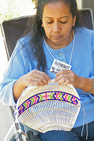 Kaibab Indian Reservation - Angie Bulletts (Kaibab Paiute) weaves a Paiute cradleboard, Arizona, 2011