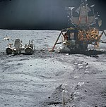 John Young works at the LRV near the Lunar Module Orion