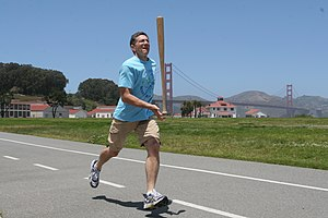 Ashrita Furman - Furman in San Francisco setting a record for the fastest mile balancing a baseball bat.