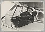 Australian Women Pilots' Association member Meg Cornwell in the cockpit of Auster J-5G Cirrus Autocar monoplane VH-ADY at an airfield, 1954 (16103886047).jpg