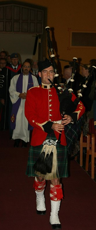 Convocation - A cadet of the Royal Military College of Canada plays bagpipes in Currie Hall during the College's fall Convocation.