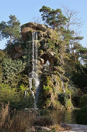 Water feature - Artificial waterfall in the park of Bagatelle, France.