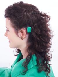 Baha user sound processor behind ear.PNG