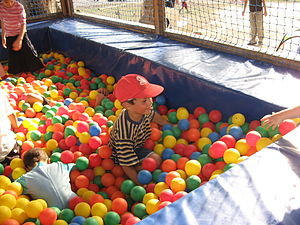 Ball pit - A child playing in a ball pit