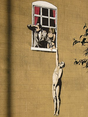 English: Close up shot of graffitti by Banksy ...