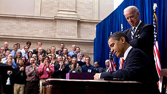 American Recovery and Reinvestment Act of 2009 - President Barack Obama signs the ARRA into law on February 17, 2009 in Denver, Colorado. Vice President Joe Biden stands behind him.