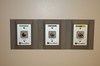 Atlas Copco - BeaconMedaes oxygen, vacuum, and medical air medical gas supply outlets on a ceiling at Campbell County Memorial Hospital in Gillette, Wyoming
