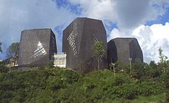 Spain Library,  a modern, art-shaped architectonic and huge library built at the top of the highest slops of northern Medellín and in one of the former most violent quarters of the city, today a symbol of peace and a real tourist spot.