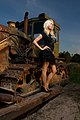 Blond woman in black clothing in a bulldozer.jpg