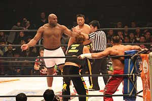 Bob Sapp - Sapp (left) and Toshiaki Kawada looking at their opponents prior to a match in HUSTLE.