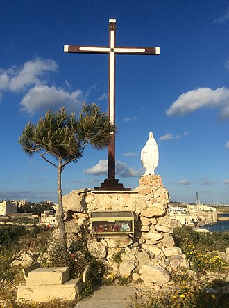 Angelik Caruana - Cross, statue and tree on the top of Borġ in-Nadur Hill around the year 2018.