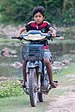 Boy riding a motorcycle in Don Det.jpg