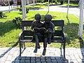 Bucuresti, Romania. Oraselul copiilor. Copii citind o carte.jpg