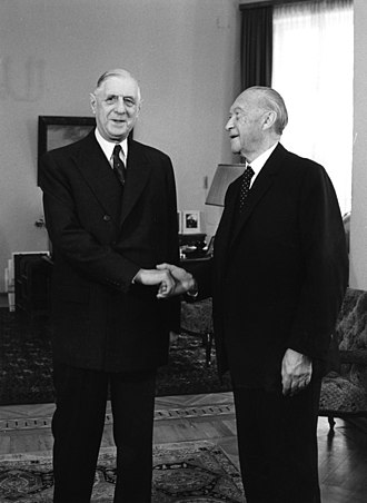 Democratic peace theory - French President Charles de Gaulle shaking hands with West German Chancellor Konrad Adenauer in Bonn, 1958, ending the French–German enmity