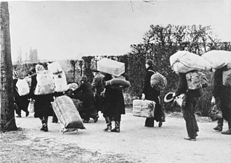 Flight and expulsion of Germans (1944–1950) - Refugees moving westwards in 1945. Courtesy of the German Federal Archives (Deutsches Bundesarchiv).