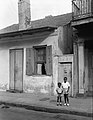 Burgundy Street La Rionada Cottage New Orleans 1938 with Two Children.jpg