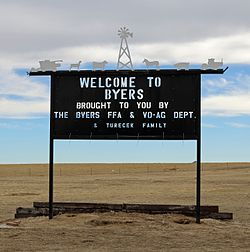 A welcome sign in Byers.