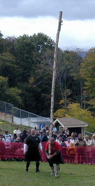 Strength athletics - A caber being tossed by Steven Labrecque at the 2000 New Hampshire Highland Games