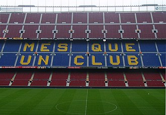 "Camp Nou - One of the stands displaying Barcelona's motto, Més que un club, meaning ""More than a club""."