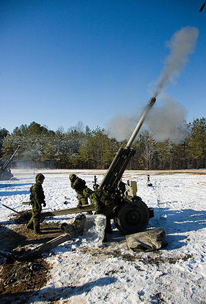 M101 howitzer - Canadian soldiers fire a high explosive round with a C3 howitzer in 2009