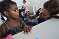 Capt. Mary White examines a patient during Continuing Promise 2015. (20660757729).jpg
