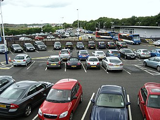 Croy, North Lanarkshire - Car Park at Croy Station with new station building in background.
