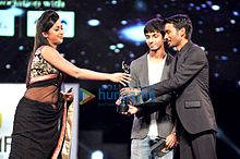 Catherine, Anirudh, Dhanush at 60th South Filmfare Awards 2013.jpg