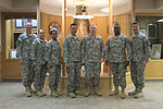 Chaplain Maj. Gen. Rutherford stands in front of bear with his team 141209-A-ID878-659.jpg